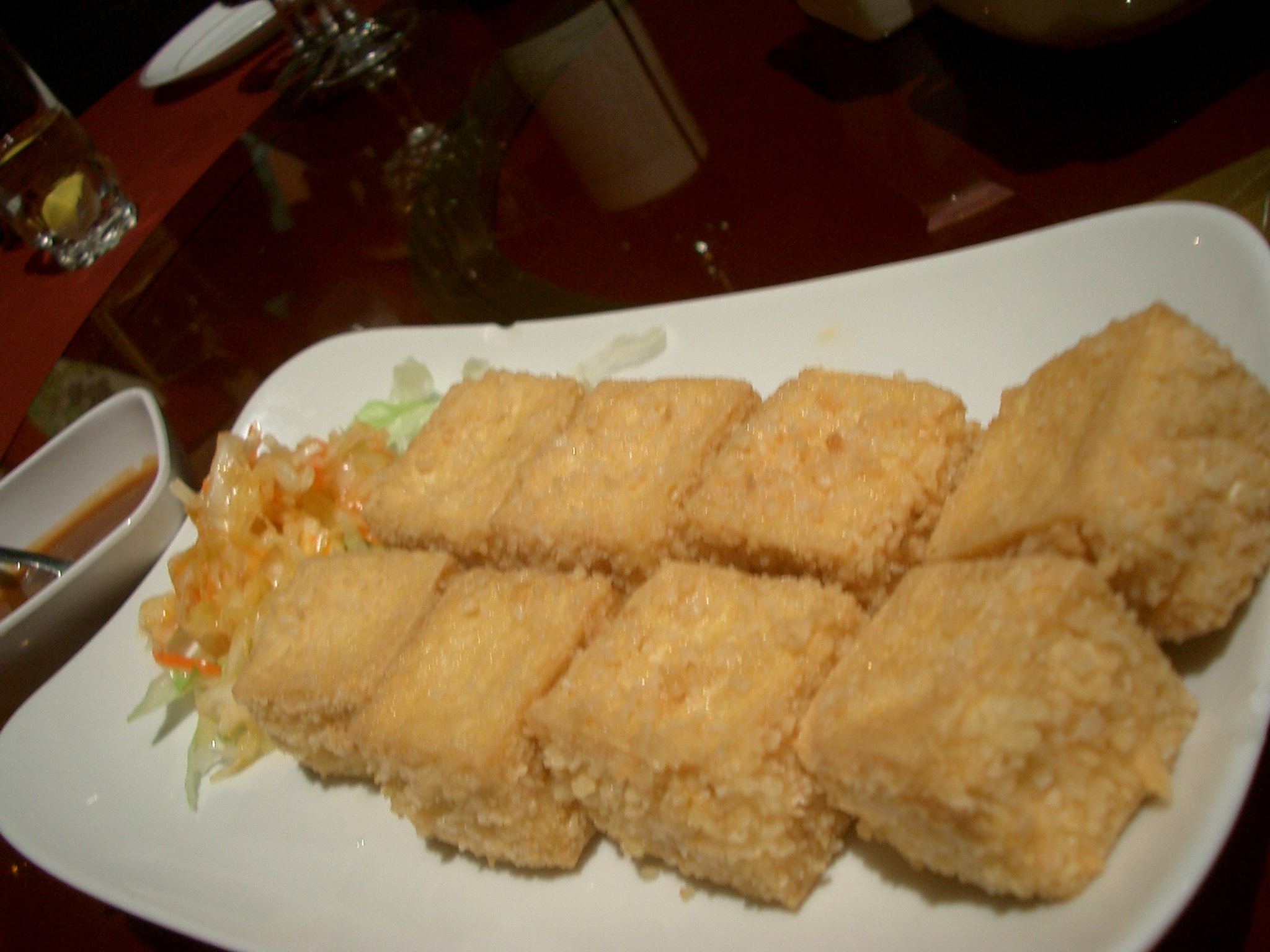 delicately crunchy exterior surrounding soft tofu. The dipping sauce ...